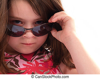 Girl with Attitude - Little girl wearing sunglasses giving...