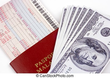 Airline Ticket And Money - Airline ticket with passport and...