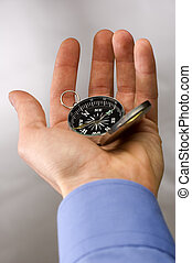compass - Hand holding the compass close up shoot