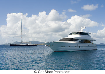 Luxury Yachts - Two luxury yachts anchored in the Caribbean
