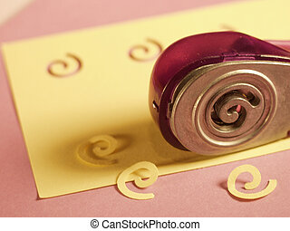 Swirl hole punch - A swirly hole punch and the fruits of its...