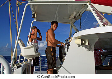 Driving the Boat - Handsome, tanned teenager enjoys steering...