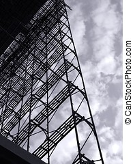 Large Scale Scaffolding - -- seen as a silhouette against a...