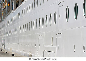 Many Portholes - Rows of portholes disappearing into the...