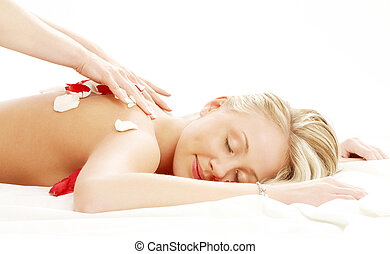 professional massage with flower petals - picture of lovely...