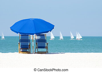 Lazy days - Beach chairs and umbrella to enjoy the sailboats