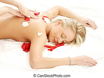 massage with flower petals - picture of lovely lady with...