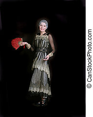 happy lady with a red fan - Standing girl with a red fan...