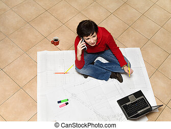 architect - home renovation: young architect working on a...