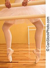 Ballet #11 - Ballerina standing at a ballet bar.