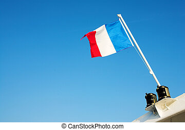 Cannes 59 - Waving French Flag in the blue sky