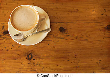 Lunch #33 - A cup of coffee on a wooden table
