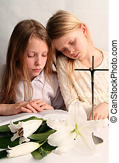 Prayer - Two sister reading holy bible together and easter...
