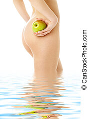 naked woman with green apple in water - naked woman with...