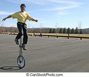 Adult man unicycling - This man in his late 30s shows that...