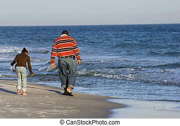 Quality time - Dad and daughter looking for clams on the...