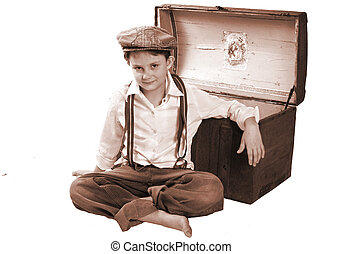 old fashion child - A child sitting up by a treasure chest...