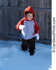 Little Boy In Snow - Cute hispanic boy playing in the snow...