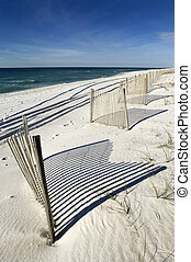 White sand beach - Empty white sand beach with fence in...