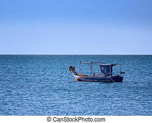 Fishing boat - A small old wooden fishing boat anchored in...