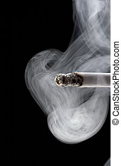 smoking cigarette - smoke like a chimney - black background