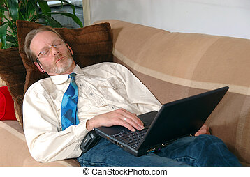 Businessman with laptop sleeping - Workaholic, businessman...