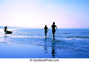 careless summer memory - silhouette image of two running...