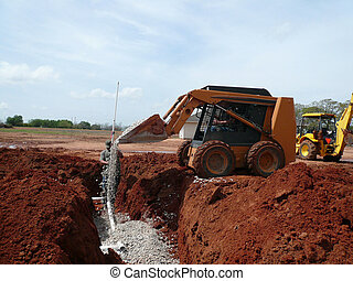 Septic System - Pouring gravel into a spetic system ditch