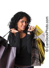 Happy shopper - Pretty brazilian woman carrying lots of...