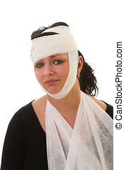 Woman with injuries on her head and arm looking unhappy