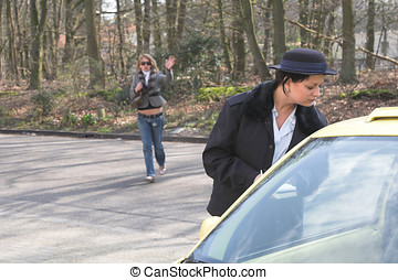 Ready to put in a ticket - Female police officer peering...
