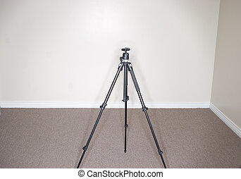 Tripod - tripod standing alone in the middle of the office