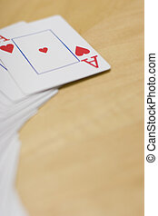 Deck of Cards on table - Deck of cards spread out on a...