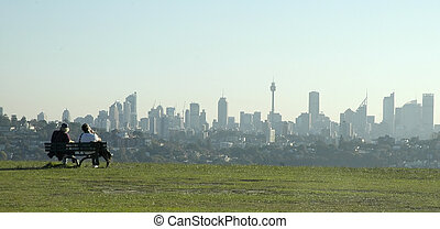 sydney scenery - two young man relaxing in park and viewing...
