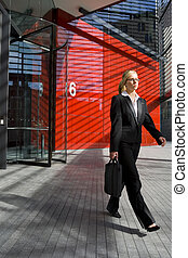 Leaving Work - A beautiful young business woman leaving work...