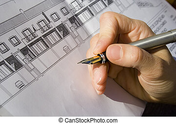 Architect project - a hand signing the architecture project...