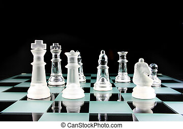 Chess Pieces on a glass board - Chess Game - Chess Pieces on...