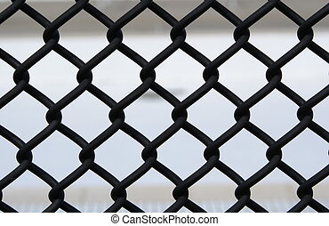chain link fence - a close up of a balck chain link fence