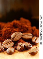 Coffee beans and ground coffee - Macro image of coffee...