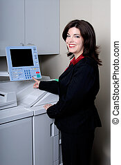 Photocopying - Attractive Brunette Young Woman Photocopying...