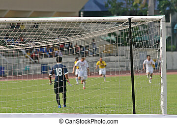 Football game - focus on the goal with a football (soccer)...
