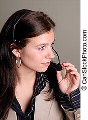 Company Receptionist - Attractive Young Woman Using A...