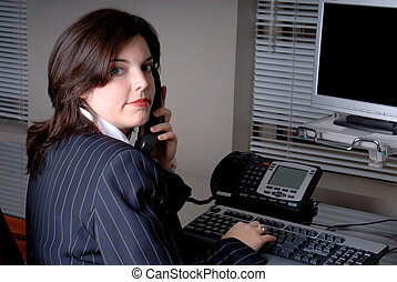 Woman On The Phone - Young Businesswoman Sat At Her Office...