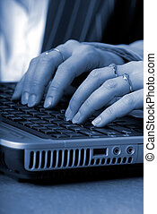 Computer Keyboard - Woman Typing On A Laptop Computer...