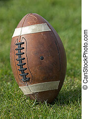 Football - closeup of football standing upright on the...