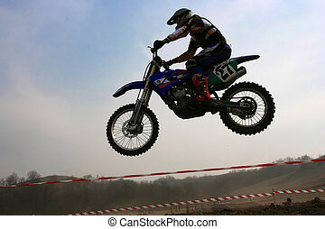 Air jump - Sportsman flying on his off road motorbike