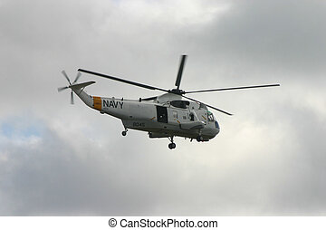 US NAVY SEAKING - A US Navy Sea King helicopter hovering up...
