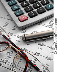 financial statement - close-up of a calculator, pen and...