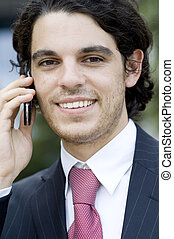 Outside Business - A young businessman outside using mobile...