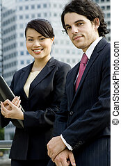 Business People In City - A young businessman and...